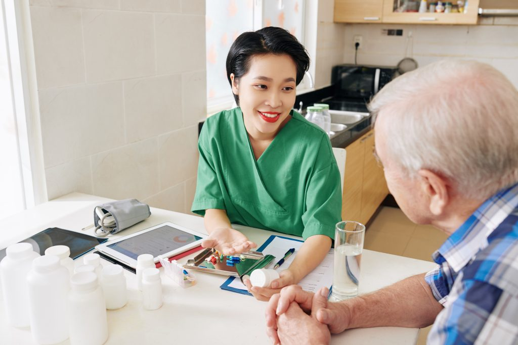 nurse at 360Care helping man with diabetes