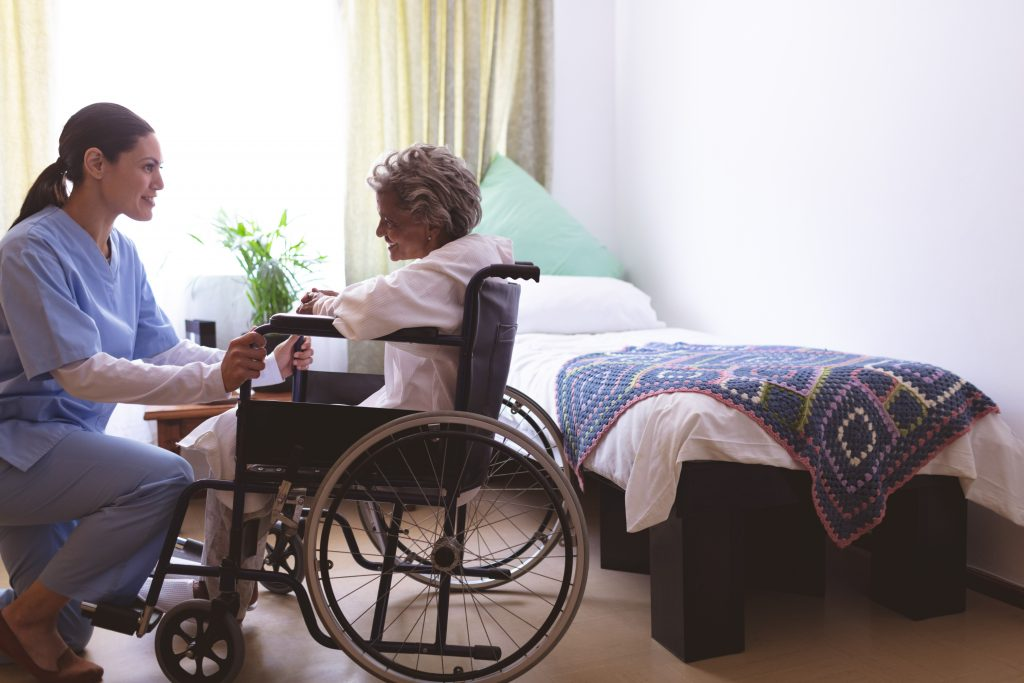 remarkable nurses at 360Care with patient in wheelchair